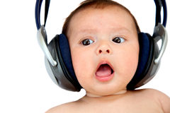 Baby with earphones Royalty Free Stock Photography