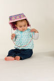 Baby with Easter Basket. A cute baby with an Easter basket on her head stock photography