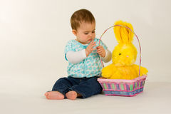 Baby with Easter Bunny. Baby with an easter basket and Eater Bunny Royalty Free Stock Image