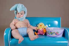 Baby in easter bunny costume Stock Photos