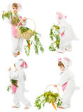 Baby in easter bunny costume with carrot basket, k Stock Images