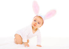 Baby in easter bunny ears on white background. Baby in easter bunny ears on a white background Stock Image