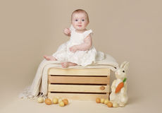 Baby with Easter Bunny and Eggs Royalty Free Stock Image