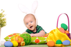 Baby with easter colored eggs. On white background Royalty Free Stock Image