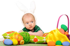 Baby with easter colored eggs. On white background Stock Photos