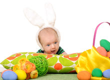 Baby with easter colored eggs. On white background Stock Image