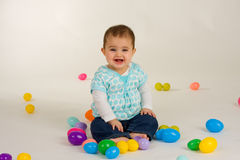 Baby and Easter Eggs. Cute baby girl with easter plastic eggs stock photography