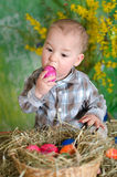 Baby with Easter eggs Stock Photos