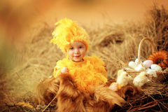 Baby in Easter nest Stock Photos