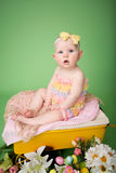Baby Easter outfit, with Eggs and Flowers Stock Photo