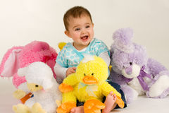 Baby and Easter Stuffed Animals. Baby happy to be with Easter Stuffed Animals royalty free stock image