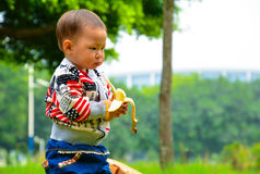 Baby eat banana. Children in addition to eat ordinary food but also eat fruit, fruit is every baby likes to eat the nutrition and health of small snacks. However Royalty Free Stock Photography