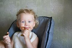Baby eat chocolate Royalty Free Stock Photos