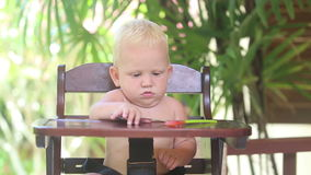 Baby Eat Porridge on Baby Chear stock video