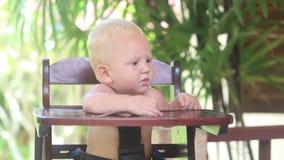Baby Eat Porridge on Baby Chear stock video footage