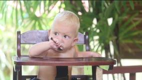 Baby Eat Porridge on Baby Chear stock footage