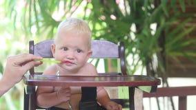 Baby eat porridge stock video footage