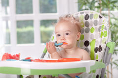 Baby eat with spoon watermelon Stock Photo