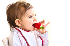 Baby eat strawberry newborn eat fruit.  royalty free stock images
