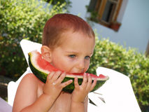 Baby eat watermelon in garden Stock Images