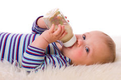 Baby eating stock photo