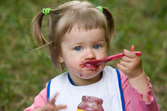 Baby eating Stock Photography
