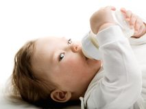 Baby eating. Photo of a baby drinking milk from the bottle Royalty Free Stock Photography