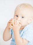 Baby eating an apple Royalty Free Stock Photo