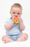 Baby eating apple Stock Photos