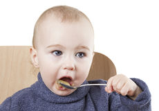 Baby eating applesauce Stock Photos