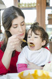 Baby eating baby Food Jar Royalty Free Stock Photography