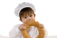 Baby eating bread Stock Photography