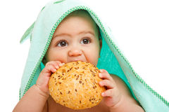 Baby eating  bun Royalty Free Stock Photography