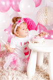 Baby eating the cake with fingers Stock Photos