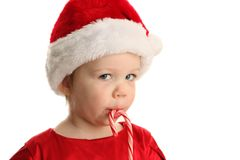 Baby eating a candy cane Stock Photo