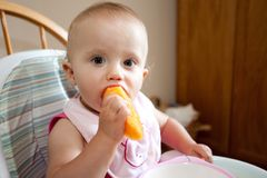 Baby eating cantaloupe Royalty Free Stock Photos