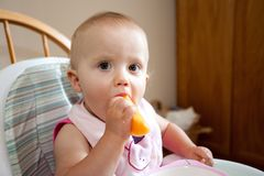 Baby eating cantaloupe Stock Photos