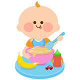 Baby eating cereal Royalty Free Stock Images