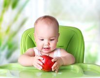 Baby eating.Child`s healthy lifestyle concept.Kid with apple. stock images