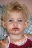 Baby eating chocolate Stock Images