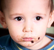 Baby after eating a chocolate Stock Photo