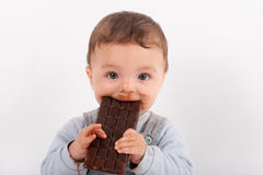 Baby eating chocolate Royalty Free Stock Photography