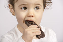 Baby eating chocolate Royalty Free Stock Photos