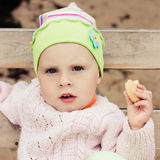 Baby eating a cracker. Stock Photography
