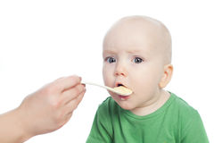 Baby eating food Royalty Free Stock Photography