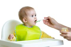 Baby eating food isolated Stock Image