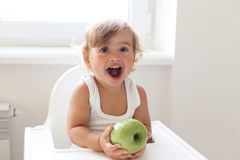 Baby eating fruit Stock Photography