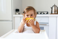 Baby eating fruit Stock Images