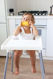 Baby eating fruit Royalty Free Stock Images