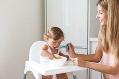 Baby eating fruit Royalty Free Stock Image